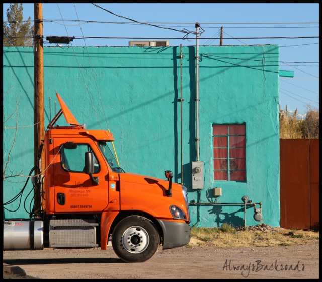 orange truck blue bldg